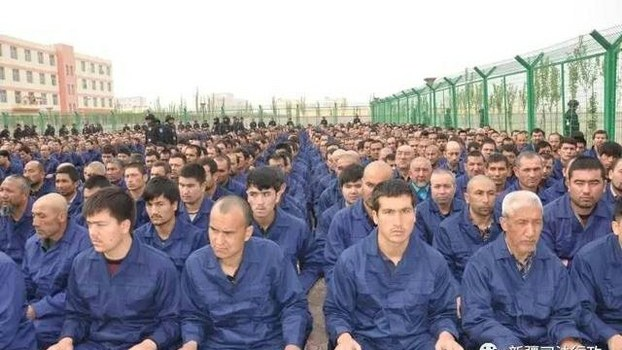 https://www.rfa.org/english/news/uyghur/transfer-10022018171100.html/uyghur-detainees-hotan-april-2017-crop.jpg/@@images/9099340c-dd10-4392-80c6-8d7a1f90175e.jpeg